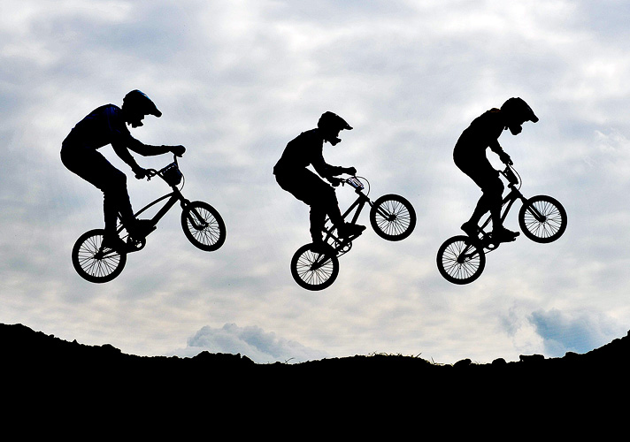 BMX riders in the middle of a jump